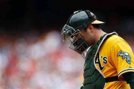 Oakland Athletics catcher Landon Powell walks to the