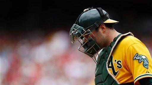 Oakland Athletics catcher Landon Powell walks to the