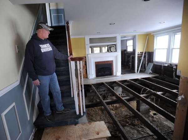 Glenn Devenish surveys the damage in his Massapequa