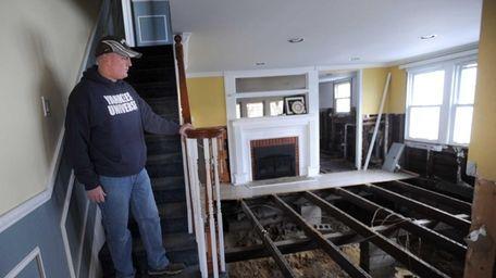 Glenn Devenish surveys the damage in his Massapequa