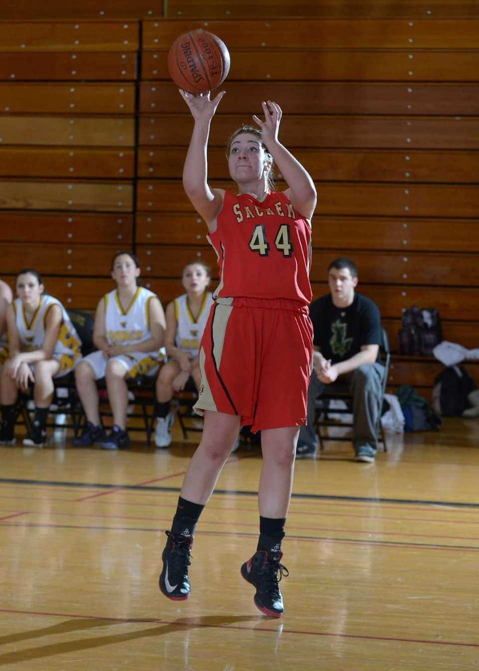 Sachem East's Allie Drake (44) takes a jump