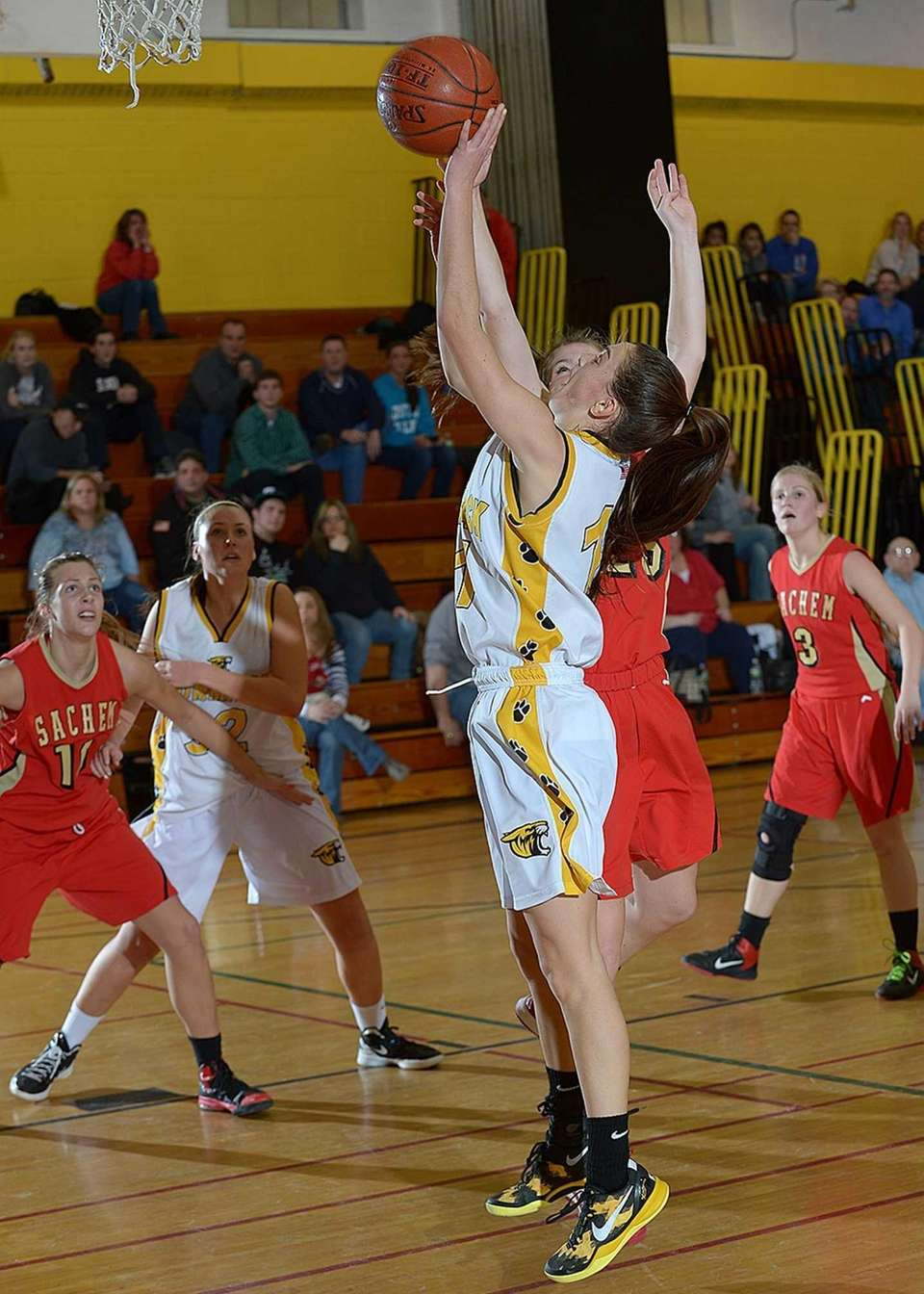 Commack's Erin Storck (11) gets foulded on the