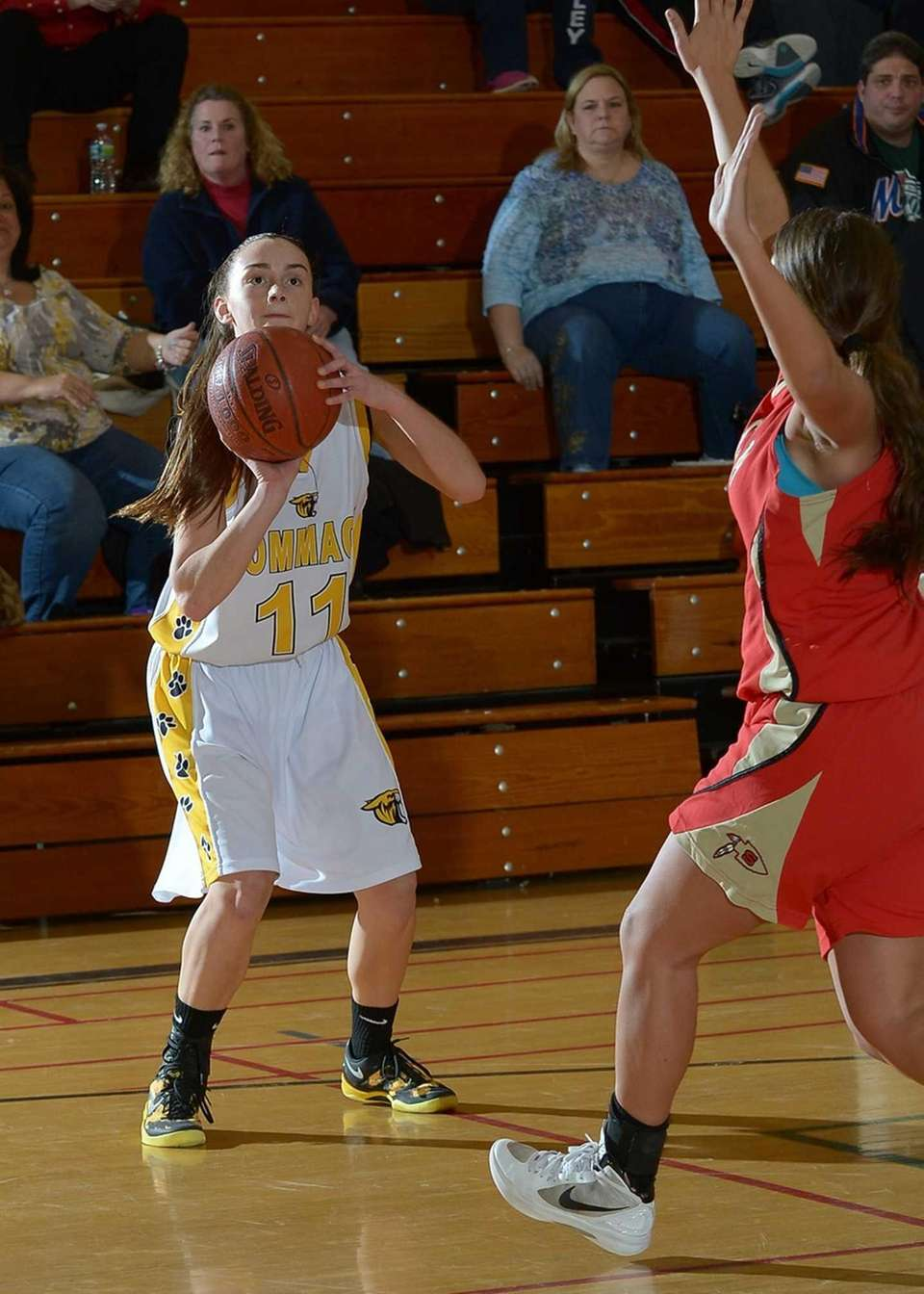 Commack's Erin Storck lines up the shot during