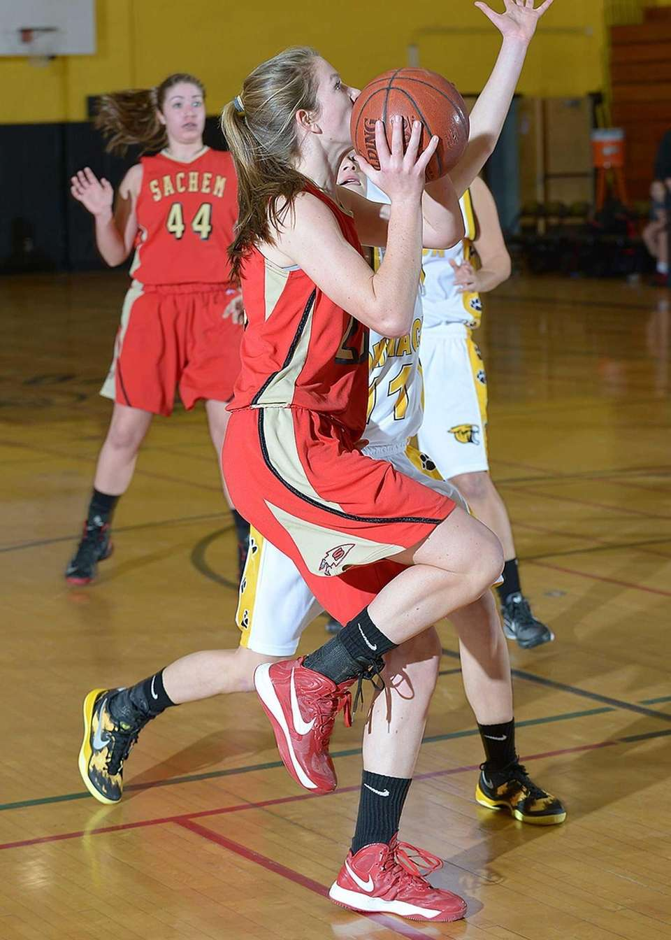 Sachem East's Kathie Doherty (25) goes up for