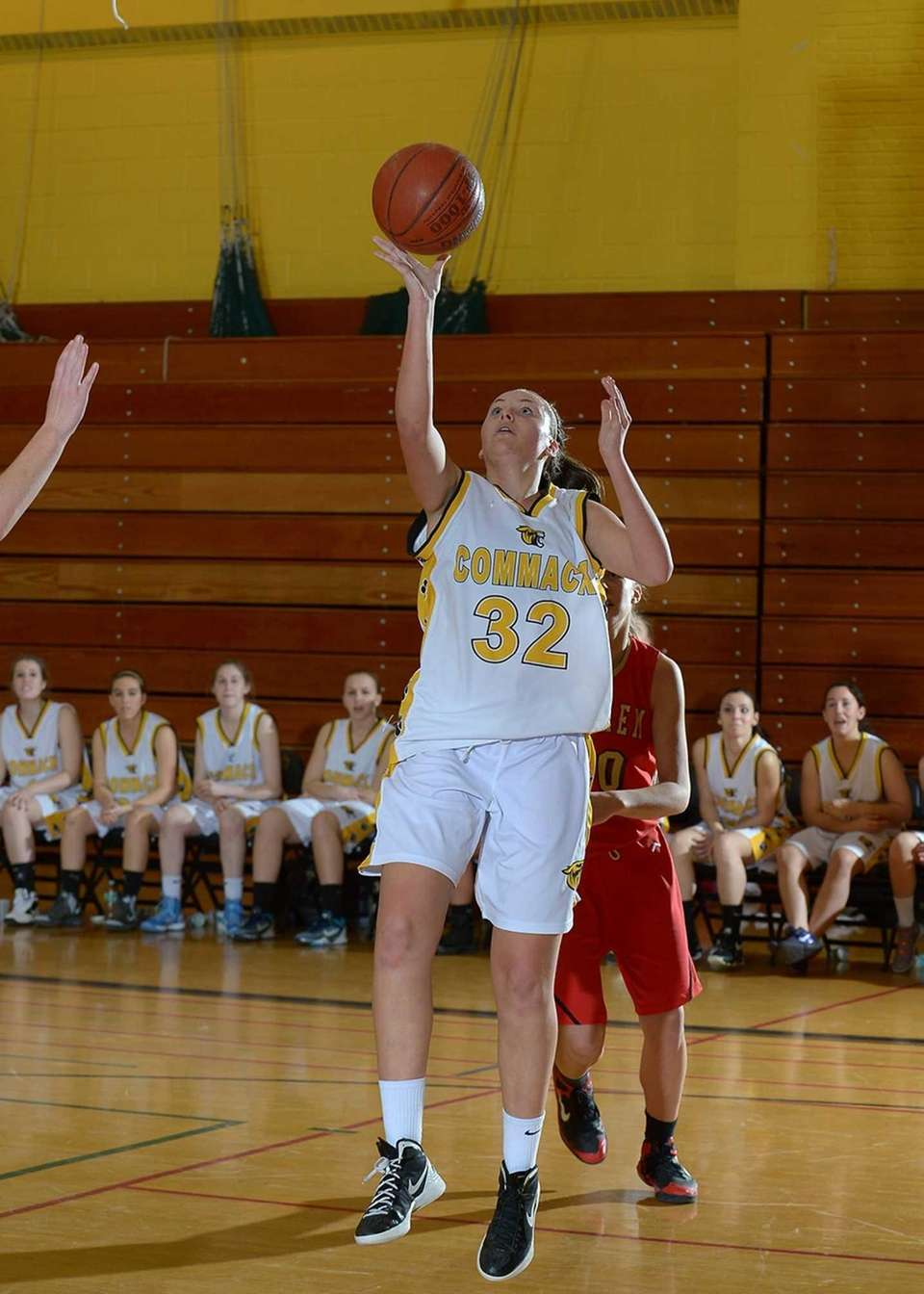 Commack's Chelsea Schultz (32) goes up for the