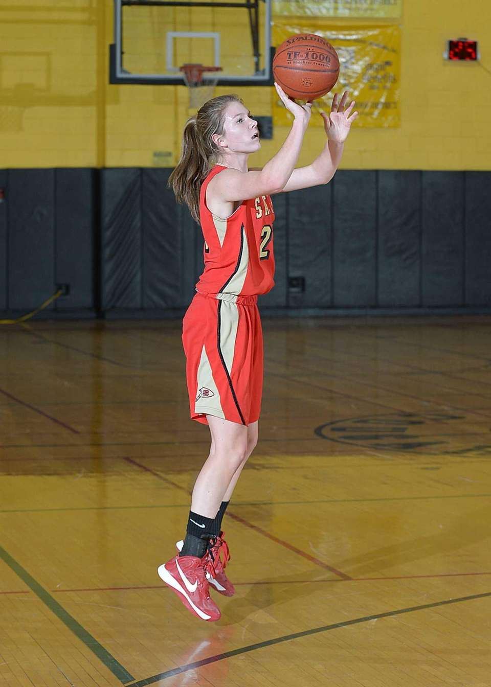 Sachem East's Kathie Doherty (25) shoots and makes