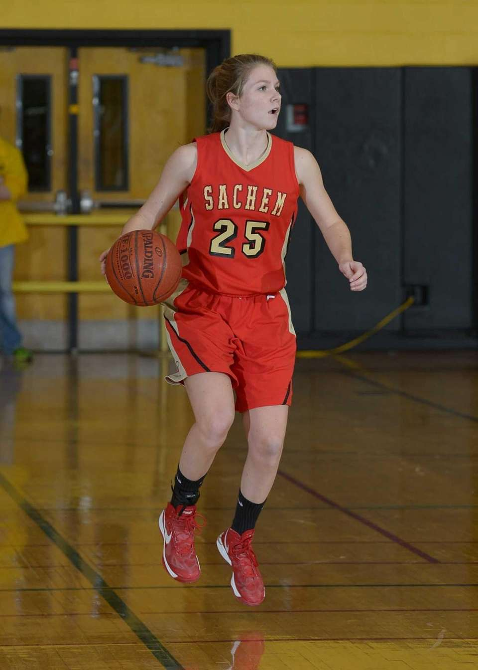 Sachem East's Kathie Doherty (25) brings the ball