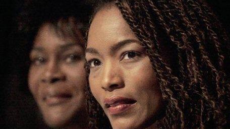 From left, Cicely Tyson and Angela Bassett listen