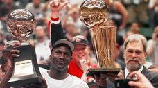 Chicago Bulls' Michael Jordan holds the Most Valuable