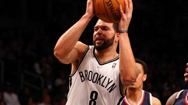 Deron Williams goes to the hoop during a