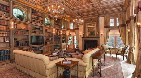 The library has coffered ceilings and built-in bookcases.