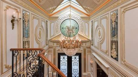 The two-story, curved wrought-iron staircase was designed through
