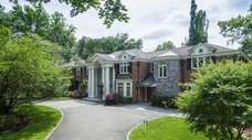 The .92-acre property has landscaped gardens and a