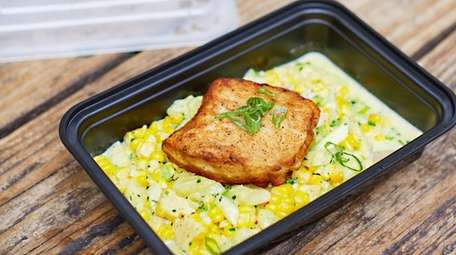 Chilean seabass with creamed corn, zucchini hearts and