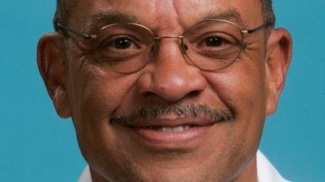 Utah Jazz director of personnel Walt Perrin poses