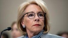 Education Secretary Betsy DeVos testifies during a hearing