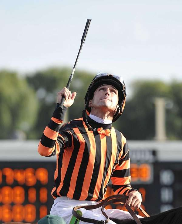 Jockey Ramon A. Dominguez, aboard Little Mike, celebrates