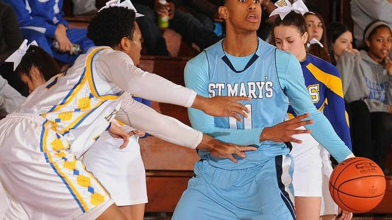 St. Mary's Devonte Green, right, looks to pass