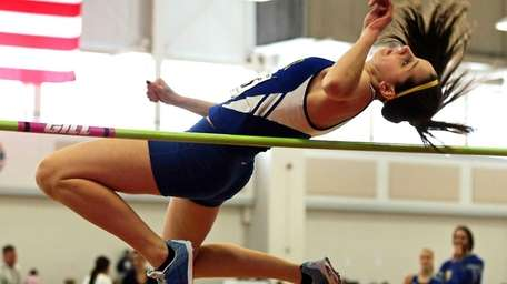 Comsewogue's Sabrena Reid, clearing the bar at five