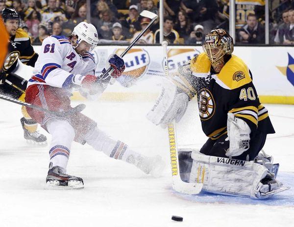 Boston Bruins' Dennis Seidenberg, far left, hooks New