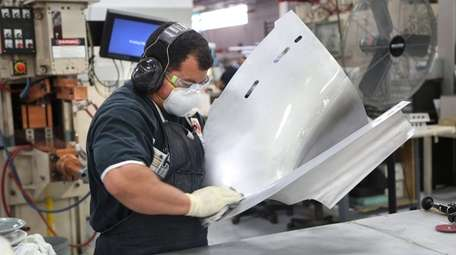 A spot welder cleans a section of the