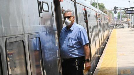 A Long Island Rail Road conductor wears a