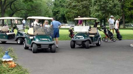Golf carts are seen at at Eisenhower Park