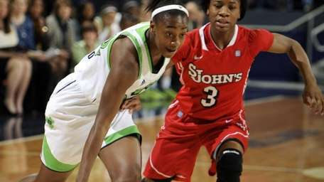 Notre Dame guard Jewell Loyd, left, drives the