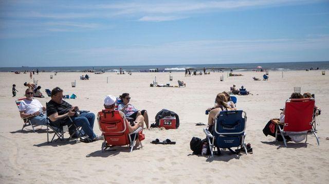 Beach-goers keep their distance at Jones Beach State