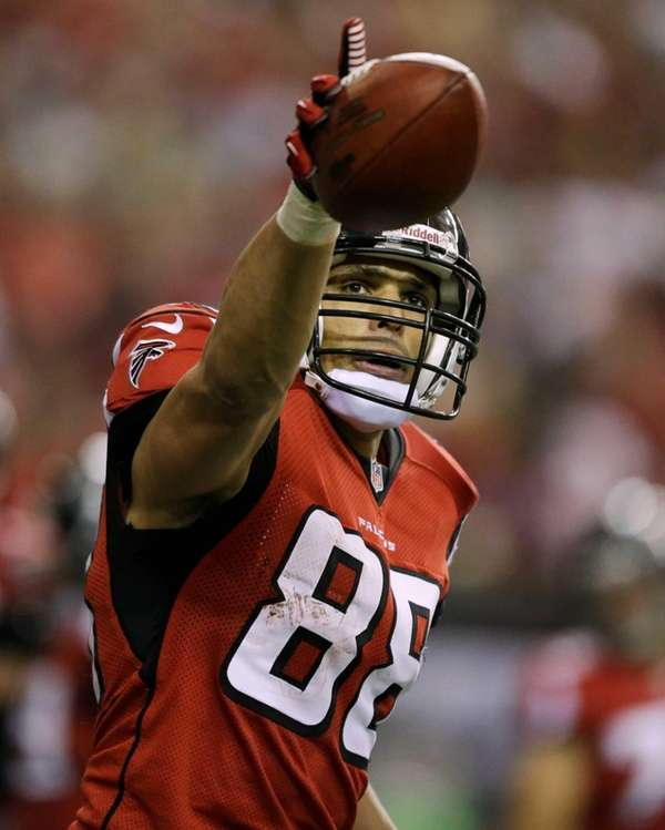 Atlanta Falcons' Tony Gonzalez celebrates after his 10-yard