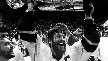 Islanders captain Denis Potvin holding the Stanley Cup