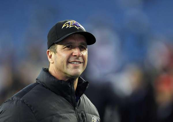 Baltimore Ravens head coach John Harbaugh waits for