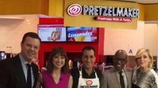 Jon Fuss, center, the owner of Pretzelmaker in