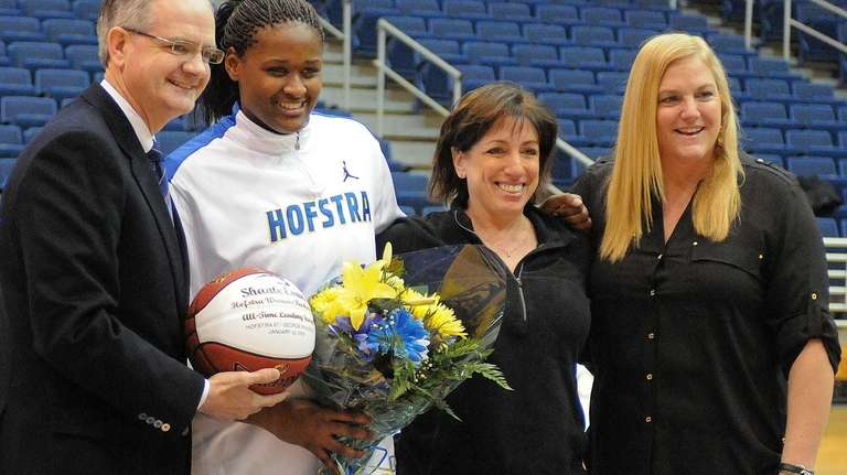 Hofstra senior Shante Evans, second from left, poses