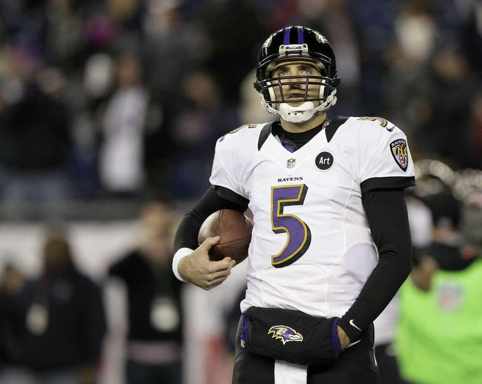 Baltimore Ravens quarterback Joe Flacco walks on the