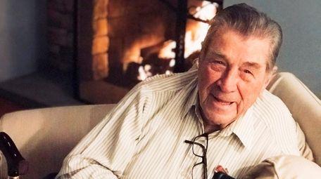 John Tomlin, of West Islip, played golf until