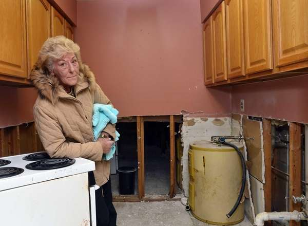 Cathy Clemente, 80, stands inside the kitchen of