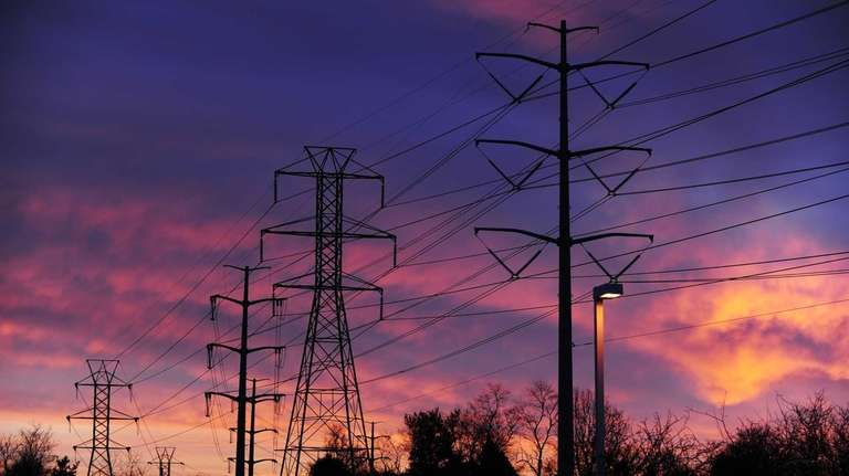 Power lines seen at sunrise in Melville on