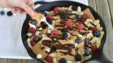 S'mores nachos can be prepared on the grill.