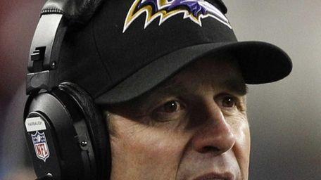 Baltimore Ravens head coach John Harbaugh watches during