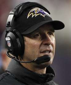 Baltimore Ravens head coach John Harbaugh watches during