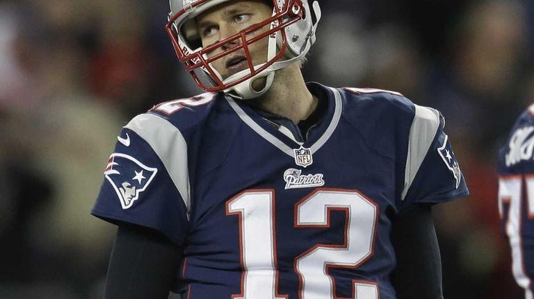 New England Patriots quarterback Tom Brady reacts during