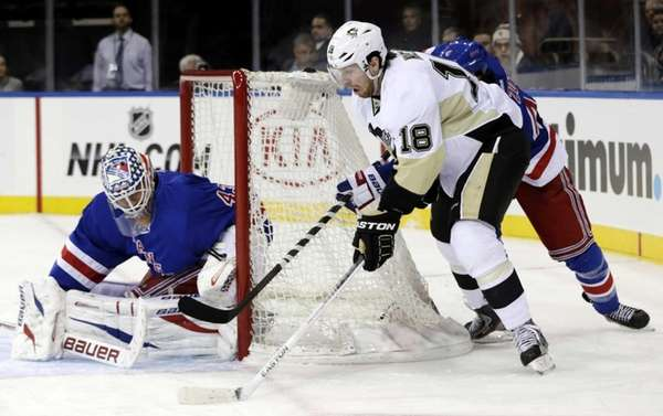 Pittsburgh Penguins' James Neal (18) shoots on Martin