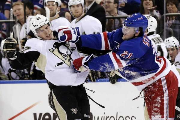 Rangers' Derek Stepan, right, pushes Pittsburgh Penguins' Sidney