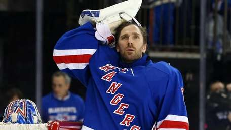 Henrik Lundqvist prepares to play against the Pittsburgh