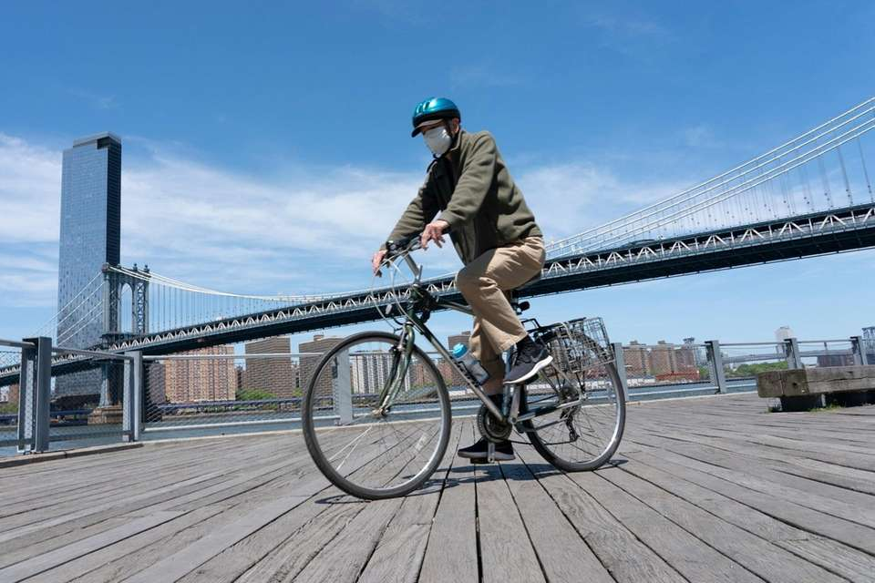 A person rides a bicycle along the East