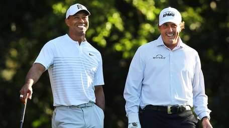 Tiger Woods, left, and Phil Mickelson share a