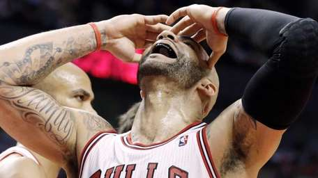 Chicago Bulls forward Carlos Boozer reacts after missing
