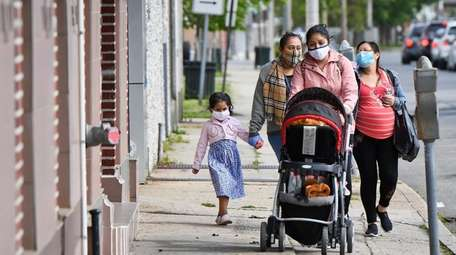 A family walks in Freeport. The state continues