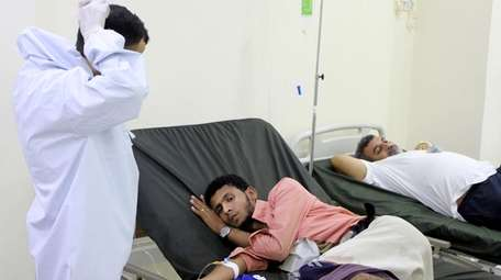 A Yemeni doctor talks to a patient receiving